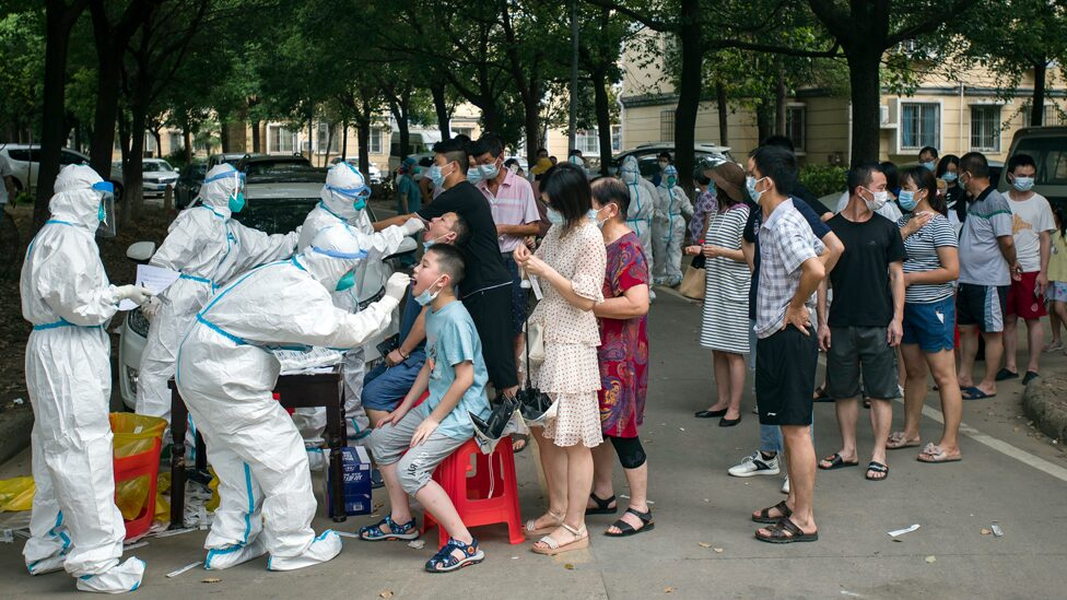 People in line undergo testing in the Chinese city of Wuhan.