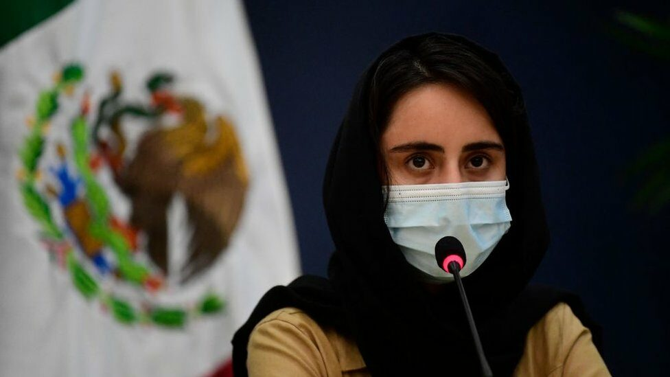"""An """"Afghan Dreamer"""" is seen during a press conference in Mexico City"""