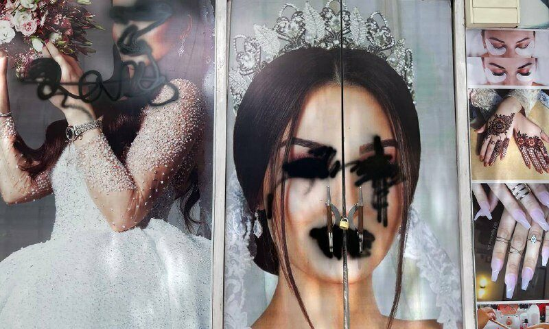 A poster of a bride with her eyes and mouth painted over