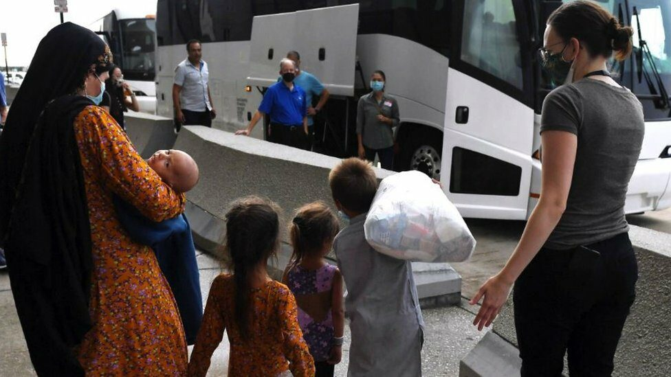 An Afghan family arriving at Dulles International Airport, Virginia, US
