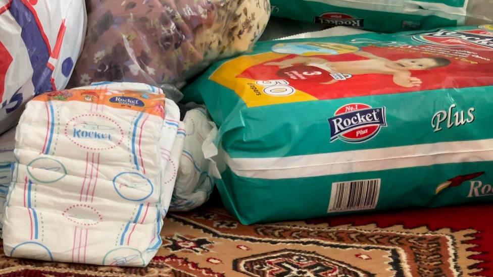 Nappies on the ground in a room at the refuge in Quetta, Pakistan