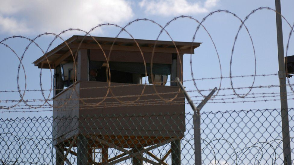 A soldier stands guard in a tower overlooking Camp Delta at Guantanamo Bay naval base in a 31 December 2009 file photo provided by the US Navy.