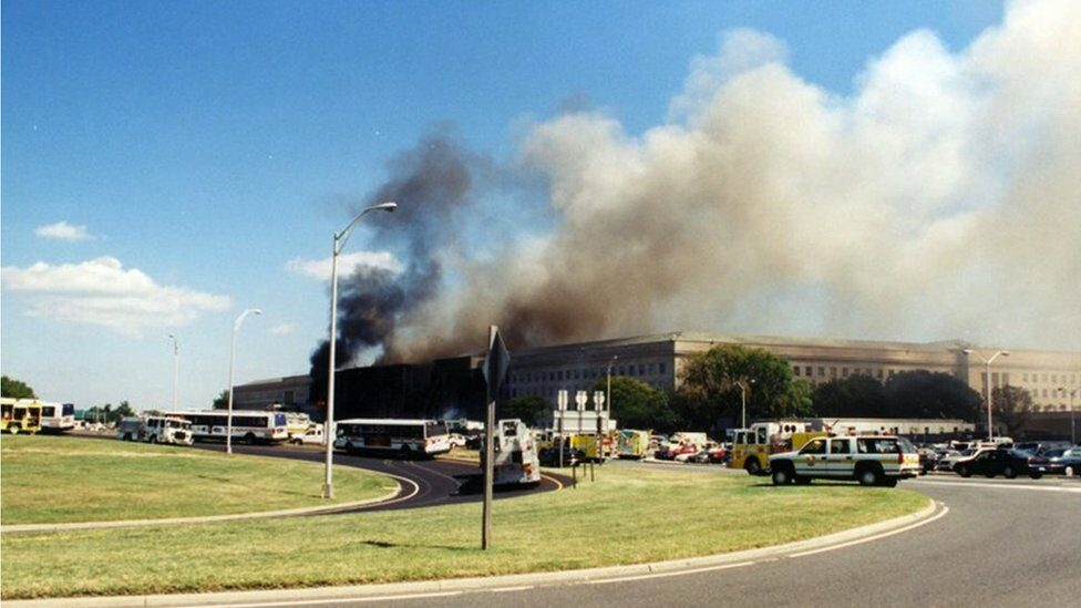 Smoke billows after the hijacked American Airlines Flight 77 crashed into the Pentagon in Arlington County, Virginia, US